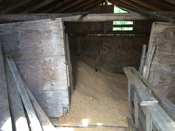 Before this new system was installed to power a community freezer and fridge, the ice house and sawdust were used to store ice over the summer.
