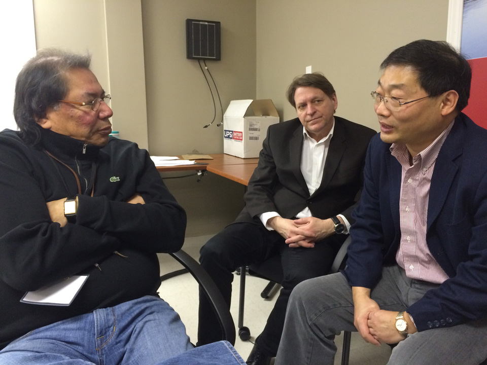 CEO Geordi Kakepetum discusses the installation of solar micro grids in the First Nations which are served by KO with Brian Lu of Canadian Solar and Ron Drews of DAI.
